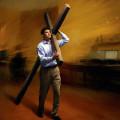 man holding cross